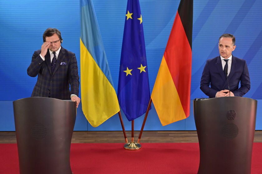 German Foreign Minister Heiko Maas, right, speaks during a joint press conference with Ukraine's Foreign Minister Dmytro Kuleba, in Berlin, Germany, on Wednesday June 9, 2021. (John Macdougall/Pool via AP)