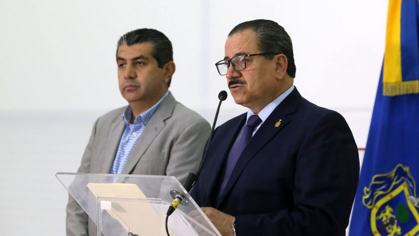 Jalisco Atty. Gen. Raul Sanchez Jimenez, right, speaks at a news conference with regional prosecutor Fausto Mancilla in Guadalajara on Tuesday.