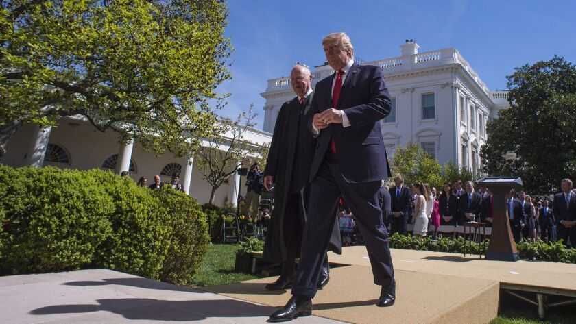 President Trump and Supreme Court Justice Anthony Kennedy walk outside the White House on April 10, 2017.