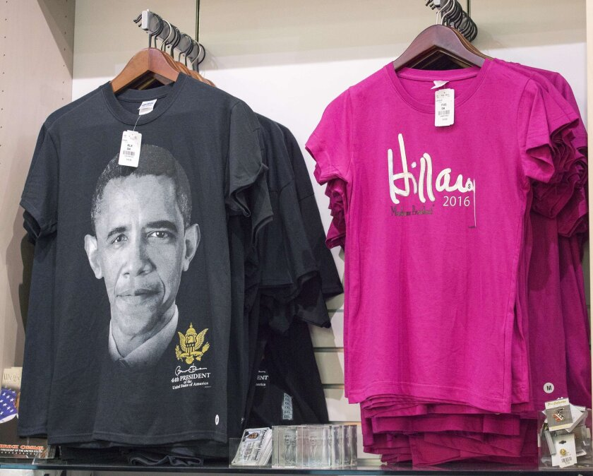 T-shirts with an image of President Barack Obama and the name of Democratic Presidential hopeful Hillary Clinton are for sale in a gift shop at Ronald Reagan National Airport in Washington on June 8.
