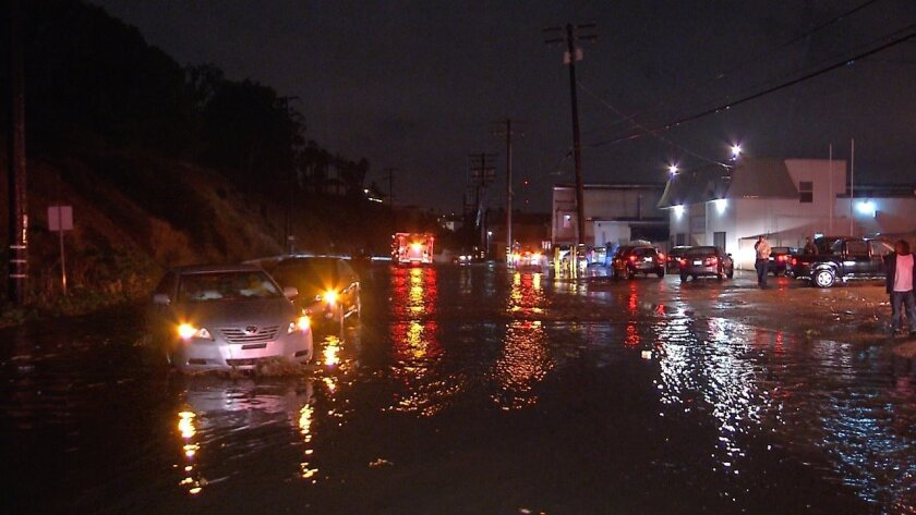 Water was more than a foot deep on Federal Boulevard between Mallard Street and Central Avenue in Lemon Grove. / Greg Torkelson / San Diego News Video