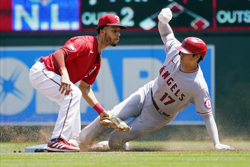 Los Angeles Angels' Shohei Ohtani (17) is tagged out at second on a steal attempt by Minnesota Twins shortstop Andrelton Simmons in the first inning of a baseball game, Sunday, July 25, 2021, in Minneapolis. (AP Photo/Jim Mone)