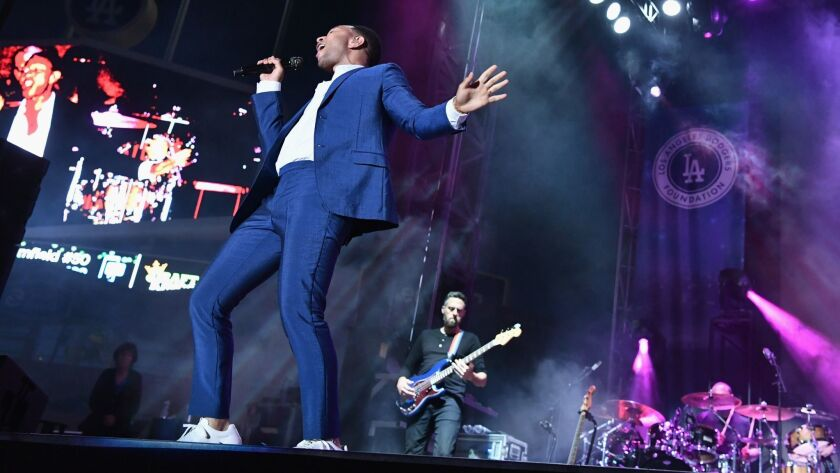 John Legend performs onstage Monday at the fourth annual Los Angeles Dodgers Foundation Blue Diamond Gala at Dodger Stadium, which raised $2.2 million for charity.