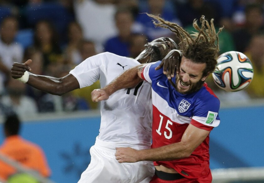 Ghana's Mohammed Rabiu, left, and Kyle Beckerman of the U.S. struggle to head the ball during a World Cup back in June.