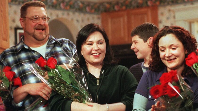 Roseanne Barr, center, basks in applause with costars John Goodman, left, and Sara Gilbert after taping was completed on the 221st and final episode of the first incarnation of the show, April 4, 1997, at Radford Studios in Los Angeles.