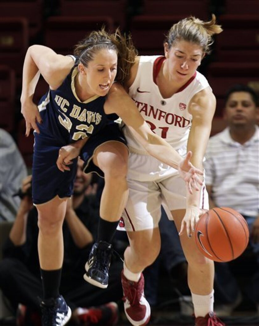 Stanford's Toni Kokenis, right, steals the ball from UC Davis' Samantha Meggison during the second half of an NCAA college basketball game in Stanford, Calif., Wednesday, Nov. 30, 2011. (AP Photo/Marcio Jose Sanchez)