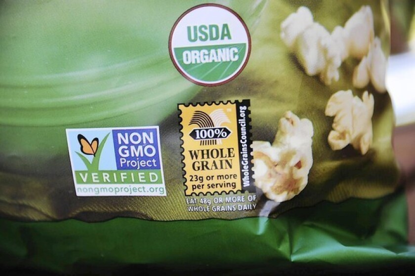 A label on a bag of popcorn shows it is a product with no genetically modified foods.