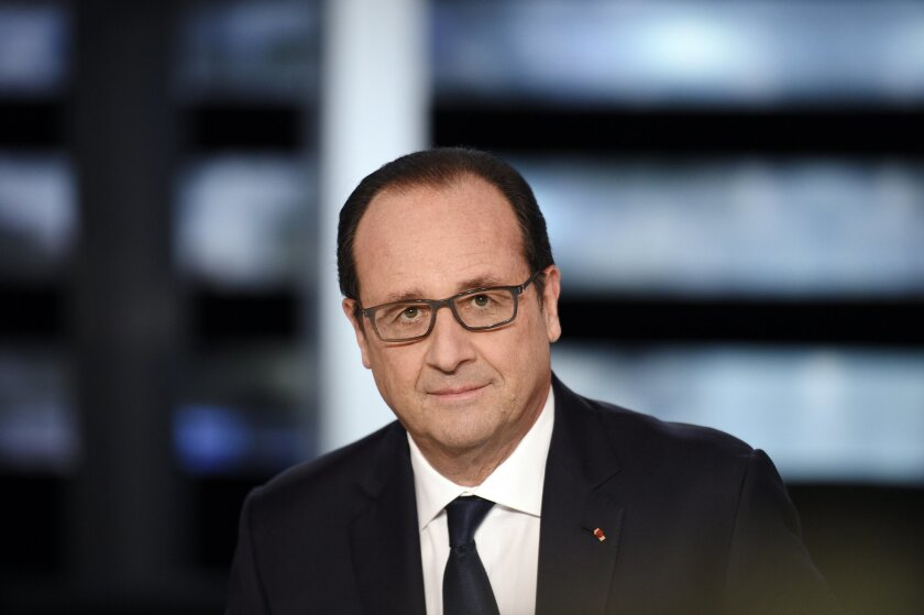 French President Francois Hollande poses on a TV set prior to the start of a French channel TF1 broadcast show, in Aubervilliers, outside Paris, France, Wednesday Nov. 6, 2014. Francois Hollande, the most unpopular French president in history, will seek to turn the tide today in a rare prime-time t