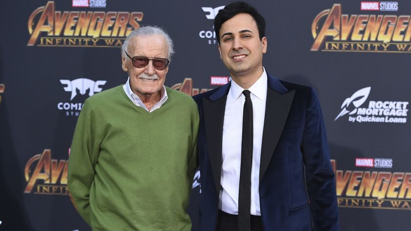 """Stan Lee, left, and Keya Morgan arrive at the world premiere of """"Avengers: Infinity War"""" in Los Angeles in April."""
