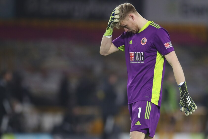 Sheffield United's goalkeeper Aaron Ramsdale reacts after the English Premier League soccer match between Wolves and Sheffield United at the Molineux Stadium in Wolverhampton, England, Saturday, April 17, 2021. (Catherine Ivill/Pool via AP)