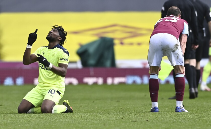 Newcastle's Allan Saint-Maximin, left, reacts following the English Premier League soccer match between Burnley and Newcastle United at Turf Moor in Burnley, England, Sunday April 11, 2021. (AP Photo/Stu Forster/Pool)