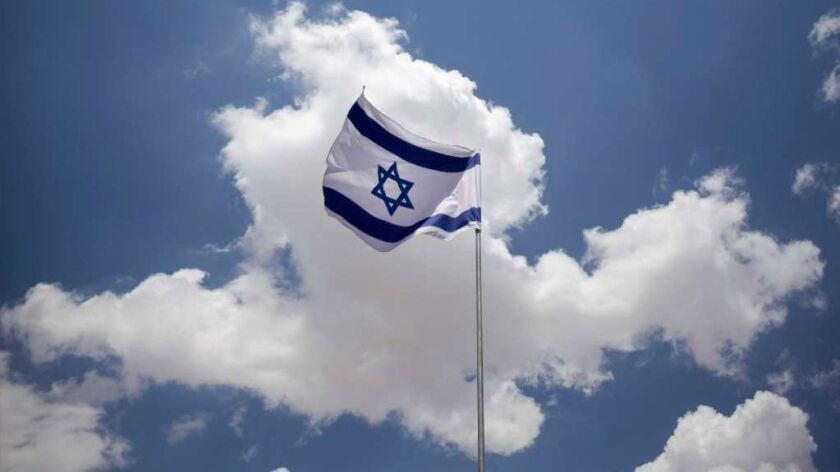 Wind blows through an Israeli flag hanging over Jerusalem's Old City in 2009.