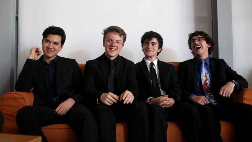 Teens Luca Mendoza, left, Benjamin Champion, Ethan Treiman and Robby Good had original compositions played by the Los Angeles Philharmonic.