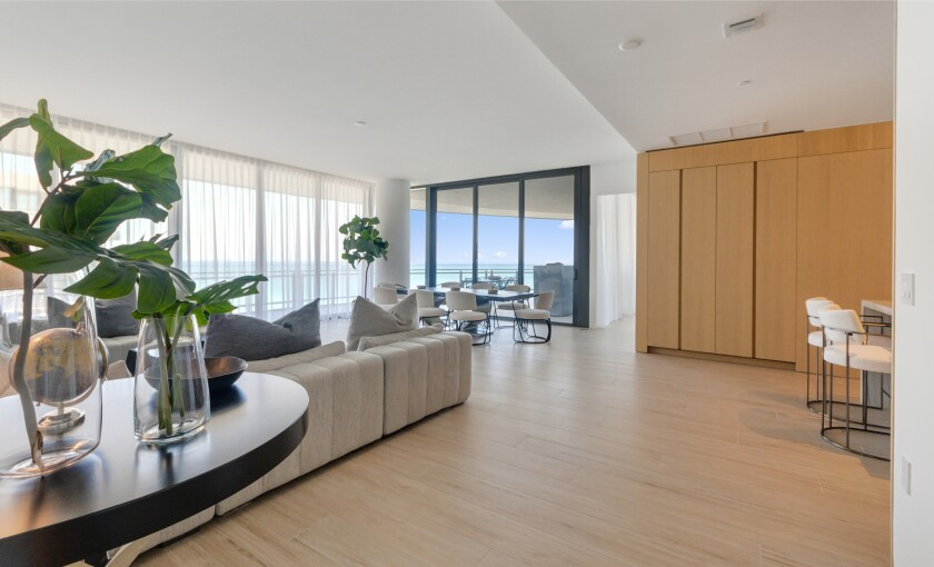 Found in a luxury complex, the condo includes 2,400 square feet of living spaces and a 1,700-square-foot wraparound terrace.