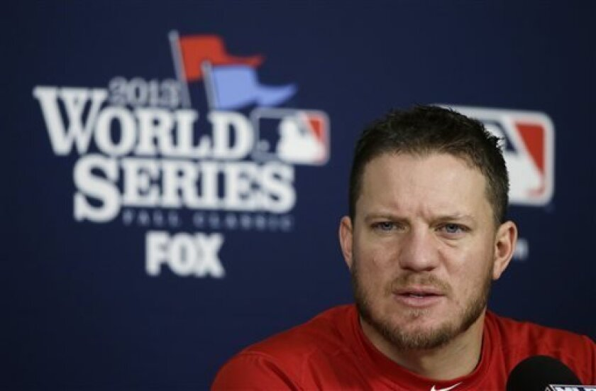 Boston Red Sox pitcher Jake Peavy speaks during a news conference before baseball practice on Friday, Oct. 25, 2013, in St. Louis. The St. Louis Cardinals and the Red Sox are set to play Game 3 of the World Series, Saturday in St. Louis. (AP Photo/Charlie Neibergall)