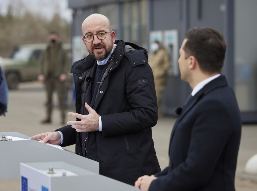 In this photo provided by the Ukrainian Presidential Press Office, Ukrainian President Volodymyr Zelenskiy, right, and European Council President Charles Michel attend a joint news briefing in the town of Shchastya in the war-hit Luhansk region, eastern Ukraine, Tuesday, March 2, 2021. (Ukrainian Presidential Press Office via AP)