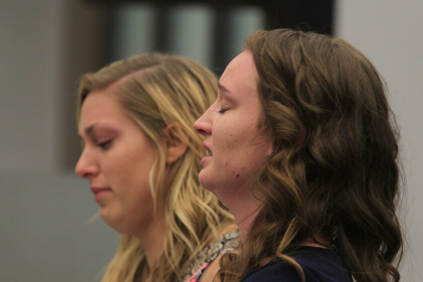 Abbey Idalski (left) reads a statement for Jannelle Harvey, the dead child's mother, during a sentencing hearing for Stanford Morocho Wednesday in Vista, California.