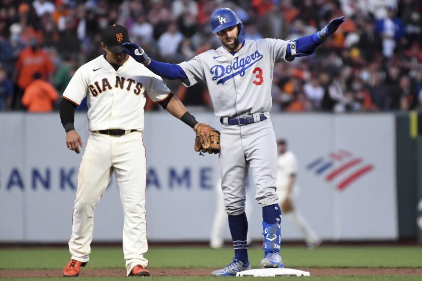 Two baseball players on a baseball field