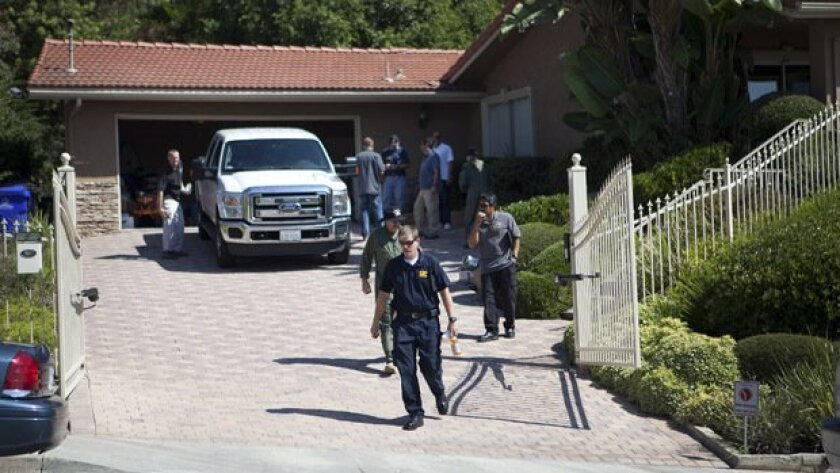 ATF and San Diego Fire Department Bomb Squad members outside a 5091 sq ft. home at 5983 Madra Avenue in Del Cerro.