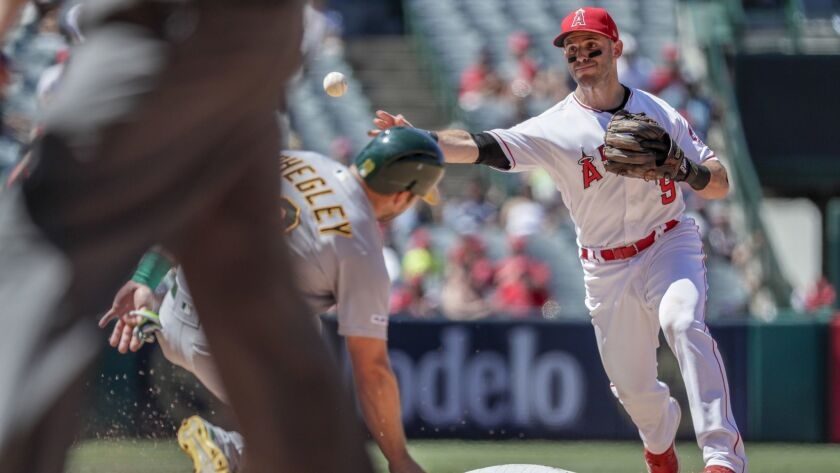 ANAHEIM, CA, SUNDAY, JUNE 30, 2019 - Angels second baseman Tommy La Stella relays a throw to first a