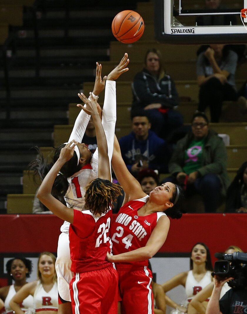 Rutgers Scarlet Knights center Rachel Hollivay (1) attempts a shot as Ohio State Buckeyes forward Alexa Hart (22) and forward Makayla Waterman (24) defend during the first half of an NCAA college basketball game in Piscataway, N.J., Sunday, Jan. 24, 2016. (AP Photo/Rich Schultz)