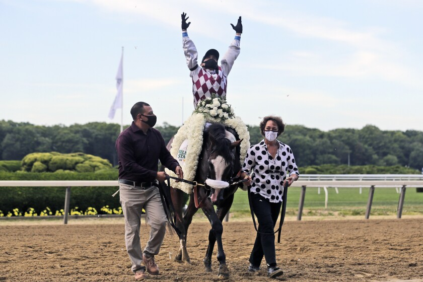 Jockey Manny Franco reacts after winning the Belmont Stakes aboard Tiz the Law on June 20, 2020, in Elmont, N.Y.