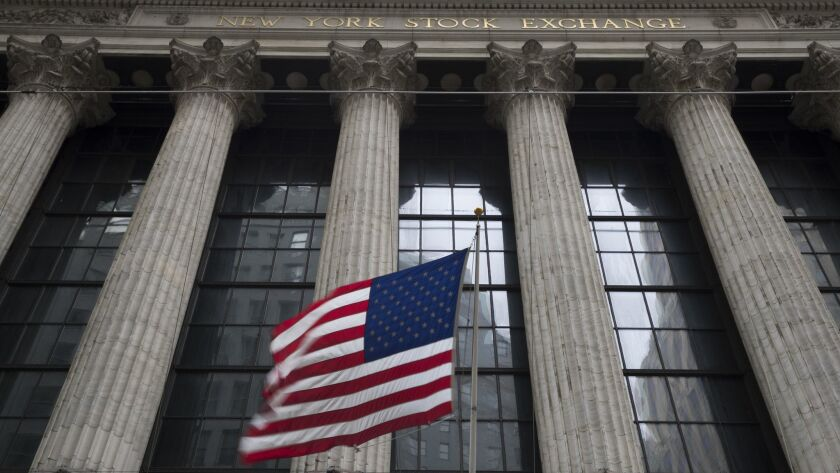 An American flag flies outside the New York Stock Exchange.