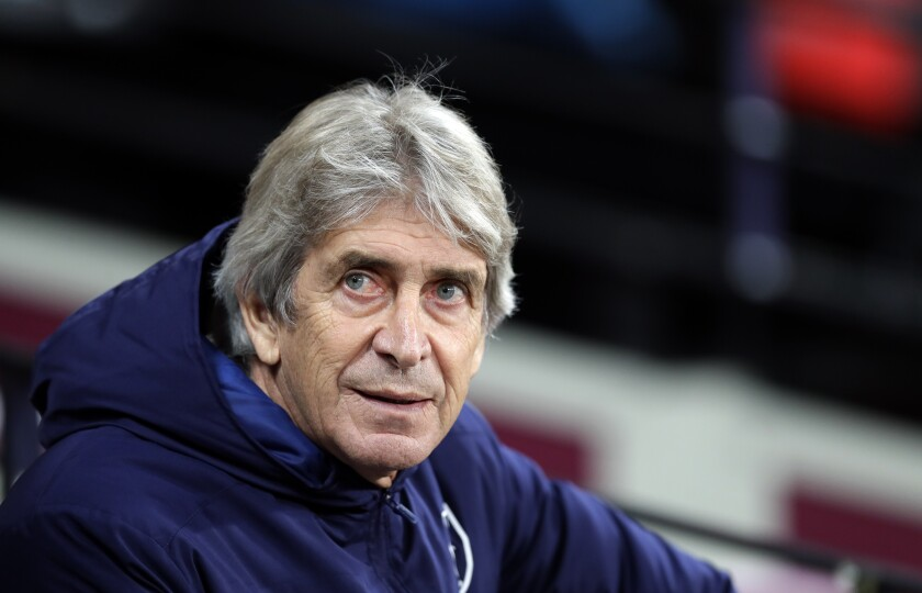 FILE - In this Monday, Dec. 9, 2019 file photo, West Ham's manager Manuel Pellegrini looks out from the bench before their English Premier League soccer match against Arsenal at the London Stadium in London. Real Betis says that Manuel Pellegrini has agreed to coach the Spanish club next season on a contract that will last through 2023. The deal was announced Thursday, July 9, 2020. (AP Photo/Kirsty Wigglesworth, file)