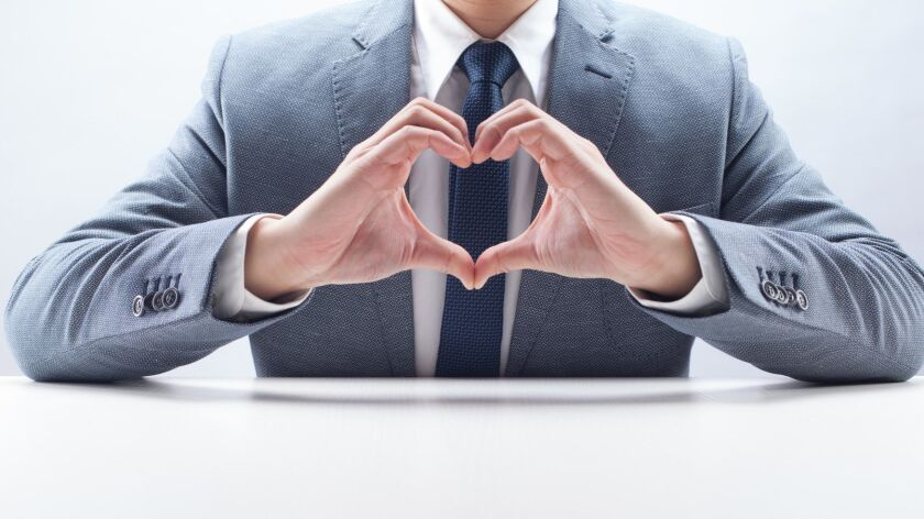 Businessman with Heart Hand Gesture