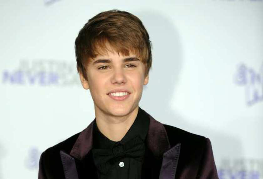 """Singer Justin Bieber arrives at the premiere of """"Justin Bieber: Never say Never"""" in Los Angeles, California on February 8, 2011."""