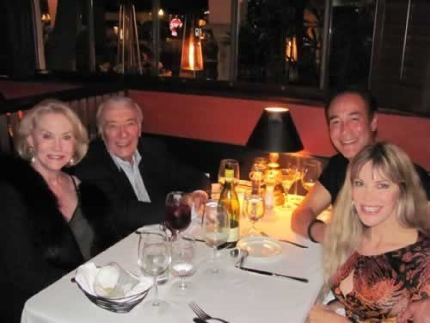 Patrons since 1948, Carol Beard and Peter Caruso (left) dine with Scott Johnston and Margo Schwab, a patron since 1974. (Photo by Susan DeMaggio)