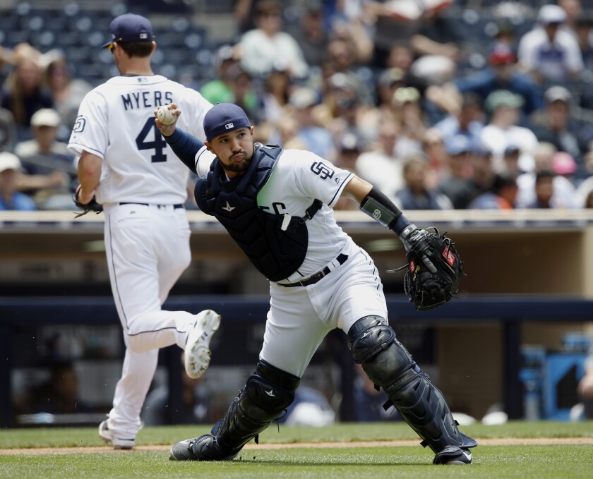 Padres catcher Luis Torrens throws out a runner at first base in a game in May 2017. The former Rule 5 pick was recalled by the Padres on Monday.