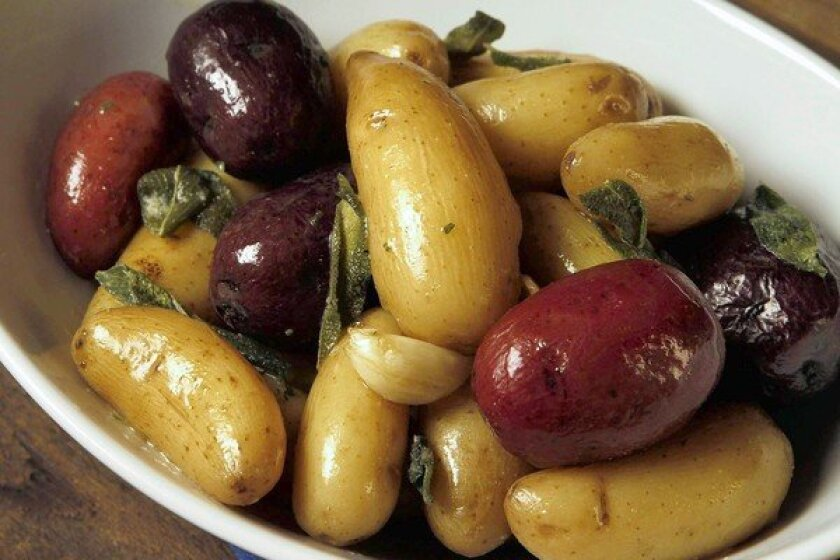 New potatoes with sage, cooked in butter. Recipe
