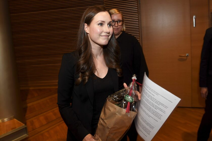 The candidate for the next Prime Minister of Finland, Sanna Marin, smiles after she won the SDP's Prime Minister candidate vote against Antti Lindtman, in Helsinki, Finland, Sunday, Dec. 8, 2019. A 34-year-old minister and lawmaker has been tapped to become Finland's youngest prime minister ever and its third female government head, replacing former Cabinet leader who resigned Tuesday. (Vesa Moilanen/Lehtikuva via AP)