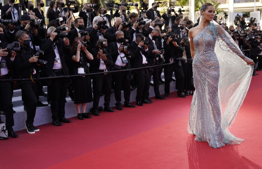 FILE - In this July 9, 2021 file photo Maeva Coucke poses for photographers upon arrival at the premiere of the film 'Benedetta' at the 74th international film festival, Cannes, southern France. As an Atlanta-based photographer who's covered major sports, breaking news, national politics throughout the United States, Brynn Anderson says she thought all her previous experience prepared her for the Cannes Film Festival. But she was wrong. (AP Photo/Brynn Anderson, File)