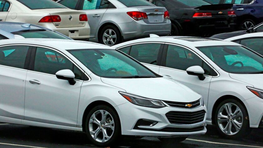 In this Thursday, Jan. 12, 2017, photo, Chevrolet cars are on sale at a dealership lot in Pittsburgh