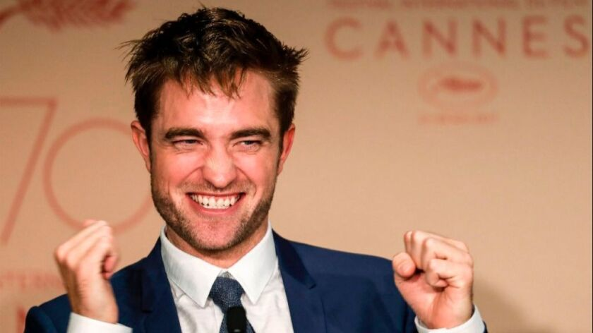 "Robert Pattinson talks at a press conference for ""Good Time"" at the Cannes Film Festival."