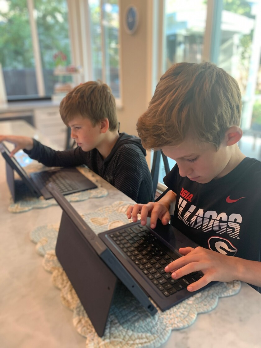 Solana Santa Fe students Liam, sixth grade, and Blake, third grade, begin distance learning in their home this week.