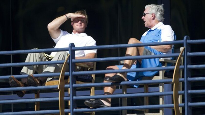 Former NFL head coach Jon Gruden  chats with Chargers General Manager A.J. Smith during the 2011 Chargers Training Camp in Murphy Canyon.