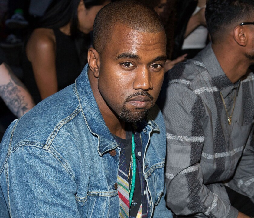 Kanye West, seen here at a New York fashion show earlier in the month, has recently put L.A. Times writer Chris Lee in his Twitter cross hairs.