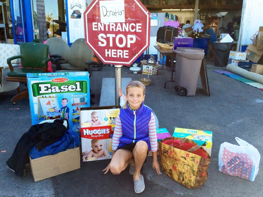 Lucie Babcock, a third-grader at Carmel Del Mar School, organized a drive for the Community Resource Center's 32nd annual Holiday Baskets program.
