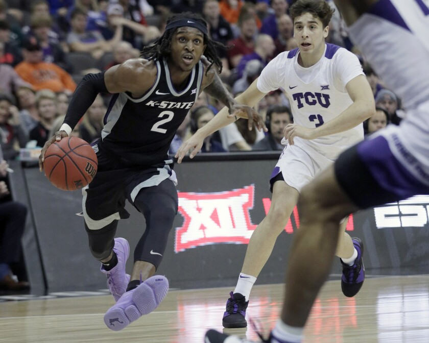 Kansas State guard Cartier Diarra (2) drives past TCU guard Francisco Farabello (3) during the first half of an NCAA college basketball game in the first round of the Big 12 men's basketball tournament in Kansas City, Mo., Wednesday, March 11, 2020. (AP Photo/Orlin Wagner)
