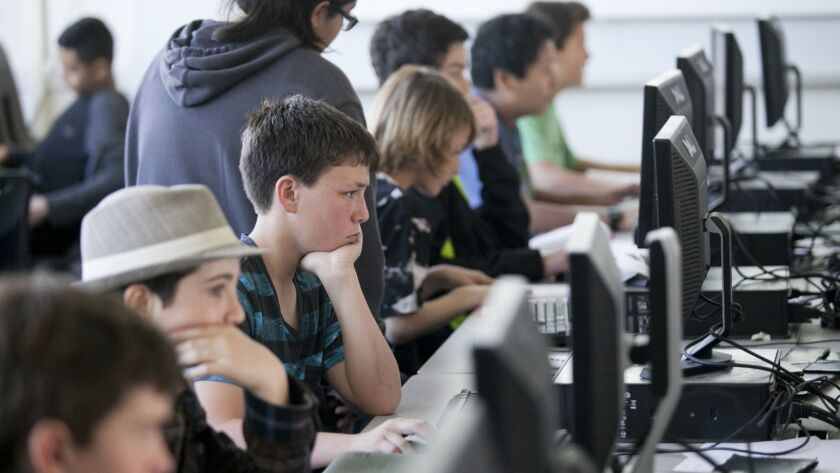 HUNTINGTON BEACH, FEBRUARY 06, 2014 - Nathan Sugano, 13, center, and his classmates work on projec