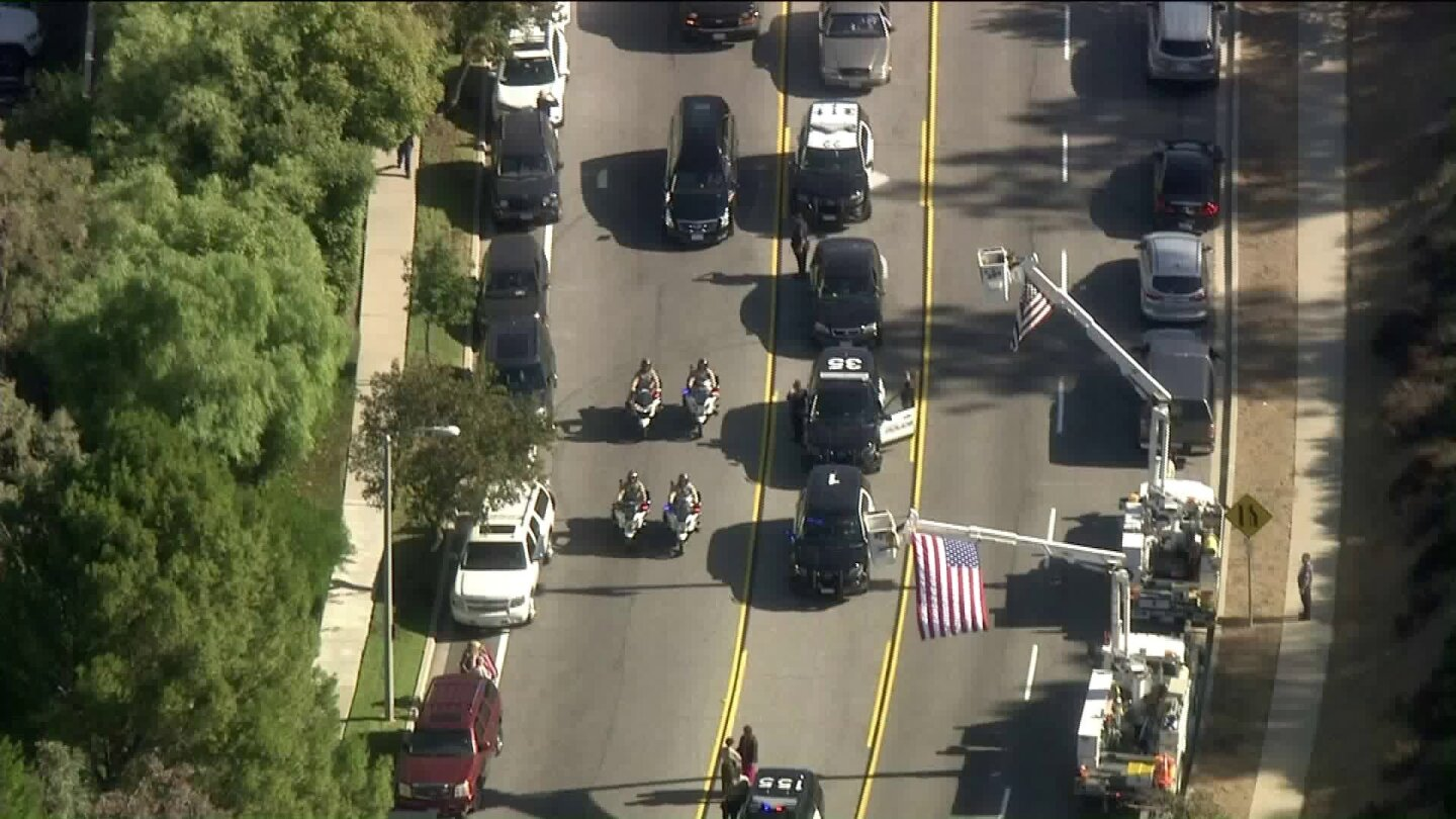 The body of Ventura County SheriffÕs Sgt. Ron Helus is escorted from the hospital in Thousand Oaks to the medical examinerÕs office in Ventura.