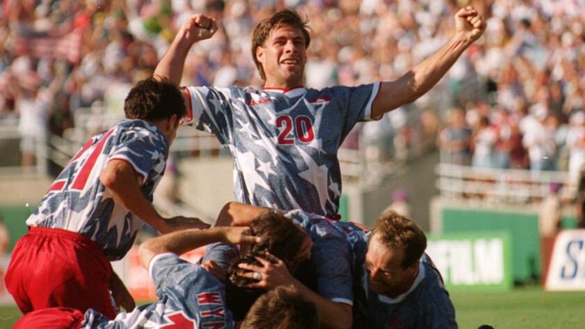 U.S. defender Paul Caligiuri, top, celebrates following a goal by teammate Earnie Stewart in a 2-1 win over Colombia at the Rose Bowl during the 1994 World Cup. The tournament served as a source of inspiration for many of the players who will be representing the United States at this year's World Cup in Rio de Janeiro.