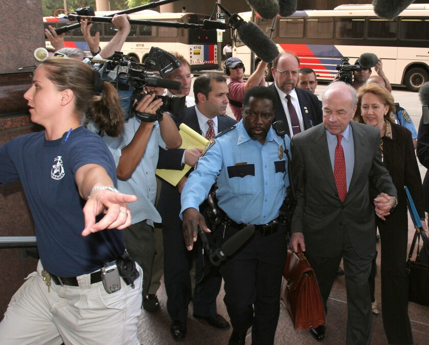 Enron founder Ken Lay (in red tie) being led from his fraud trial in 2006. Without short-sellers, the Enron ripoff might have continued for years.