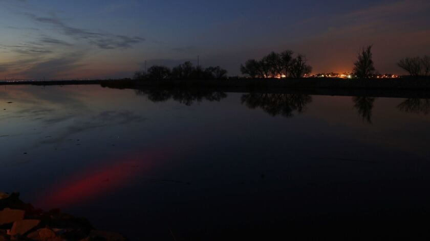 The sunset is reflected in the Middle River in the Sacramento-San Joaquin Delta.