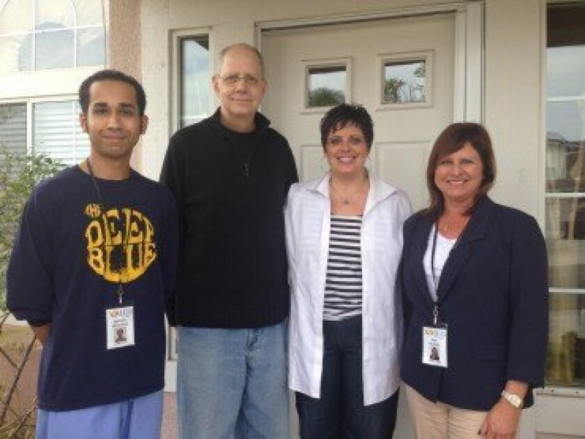 With the support of the XiMED Foundation, XiMED At Home provides free non-medical support services to oncology patients. Pictured: Caregiver Jeff Mitchell, John Wyckoff, Ramona Ferreira and XiMED At Home Operations Sue Harris. Photo/Kristina Houck
