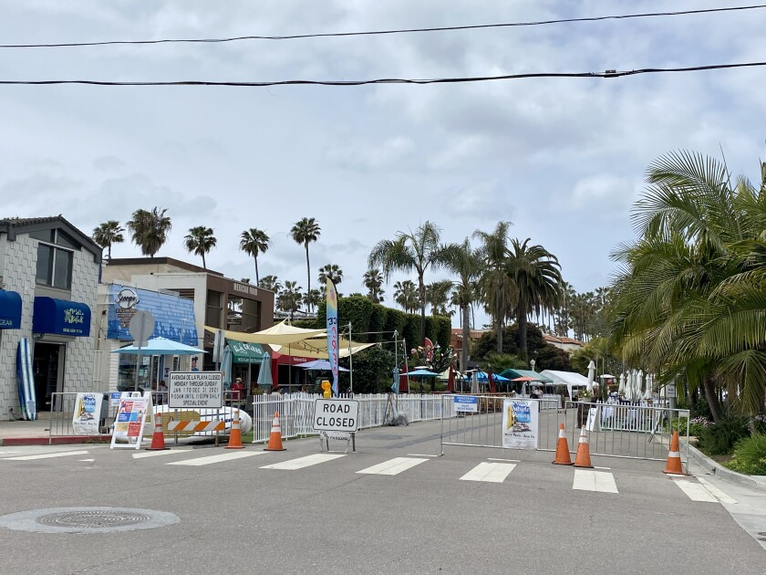 A block of Avenida de la Playa is closed to vehicle traffic to allow restaurants to place tables on the street.