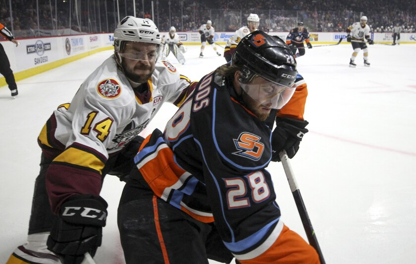 The Gulls' Justin Kloos, right, and Chicago's Matthew Weis battle for the puck in the first period during Game 5 of the AHL Western Conference finals at the Pechanga Arena on Saturday.